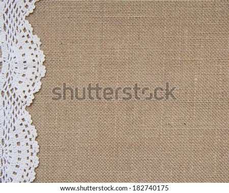 Crochet doily border over burlap - stock photo
