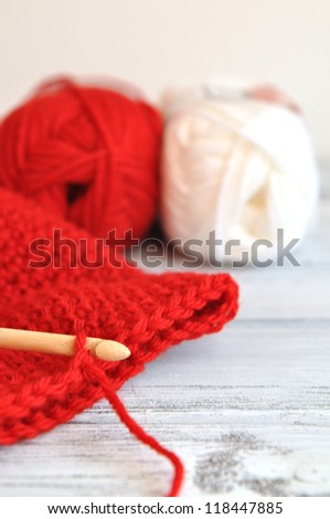 Crochet for Christmas with red and white yarn - stock photo