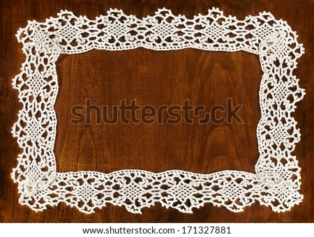 crochet frame on wooden table with space for your text - stock photo