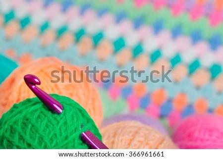 Crochet hook in the tangle thread - stock photo