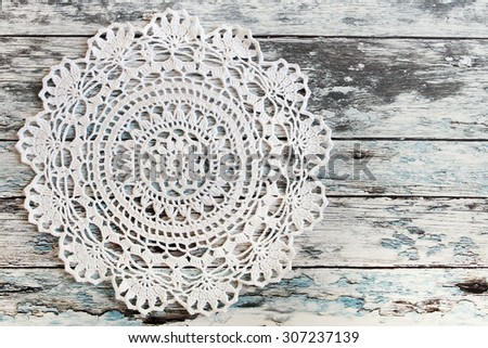 Crochet lace on on a wooden background