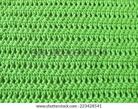 Crochet pattern from single and double crochet stitch in limegreen - stock photo
