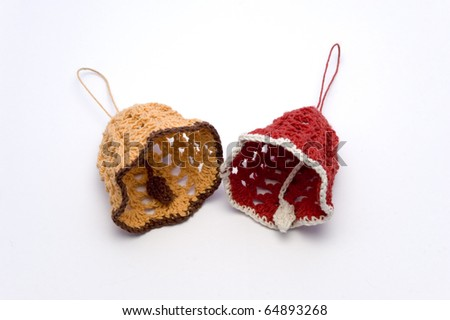Crocheted christmas bells on a white background - stock photo