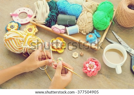 Crocheting with wool in hand. - stock photo