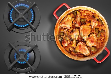 Crock on the gas stove top view - stock photo
