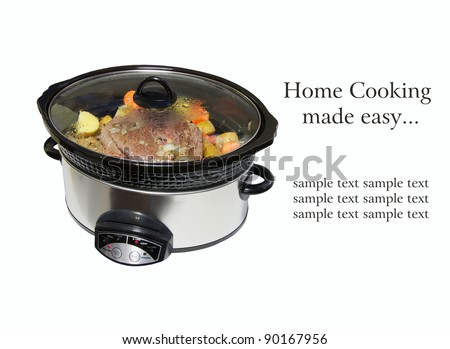 Crock pot with  a lightly browned seasoned blade roast with golden potatoes and chopped carrots simmering, isolated on white with copy space. - stock photo