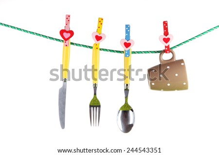 Crockery dried on rope isolated on white - stock photo