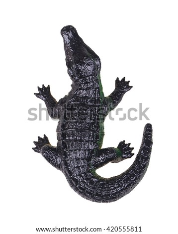 Crocodile toy  isolated on white background view from above - stock photo