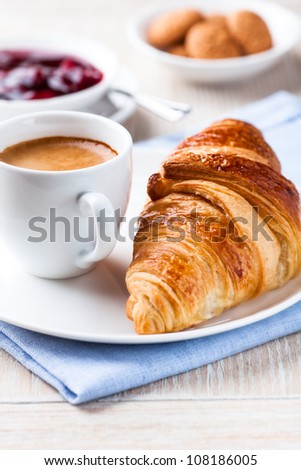 Croissant and a cup of espresso - stock photo