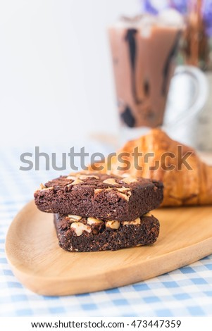 croissant and brownies on table