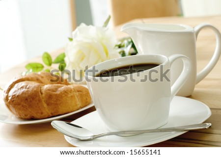 croissant and coffee - stock photo