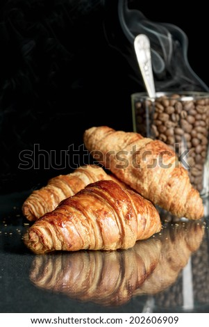 croissant and coffee beans - stock photo