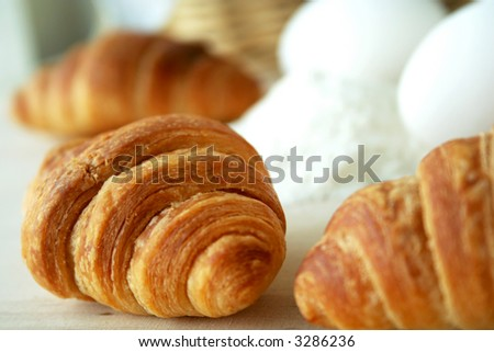 croissant and eggs - stock photo