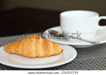 croissant bread and coffee cup