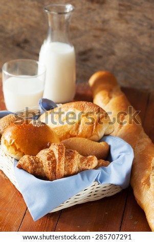 croissant ,bun and bread in basket for breakfast - stock photo