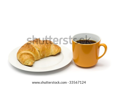 croissant on plate and coffee in orange mug isolated on white