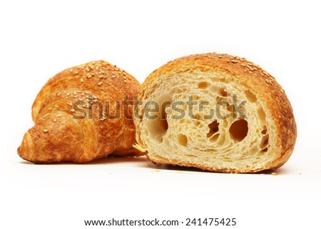 Croissant on white background, Fresh baked croissant on white with sesame seeds on top - stock photo
