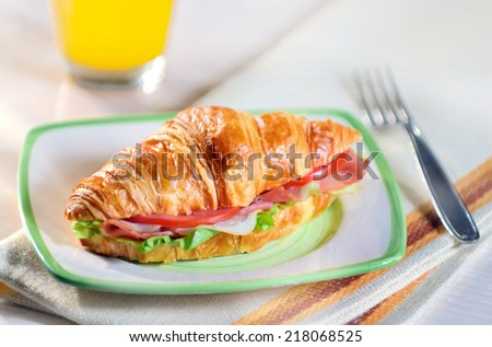 croissant sandwich with ham and vegetables - stock photo