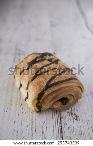 Croissant topped with chocolate - stock photo
