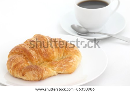 croissant with coffee isolated in white background