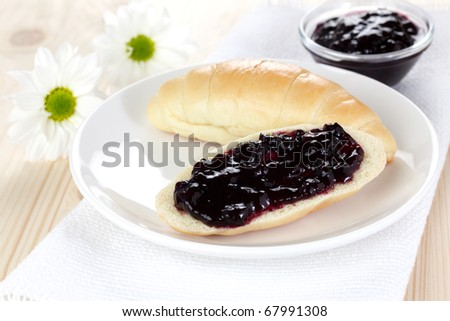 croissant with fresh jam on plate - stock photo