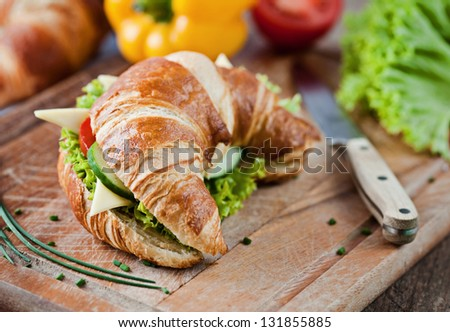 croissant with salad, cheese and tomatoes - stock photo