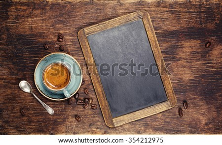 Croissants and coffee with vintage blackboard with copyspace.  Shallow depth of field - stock photo