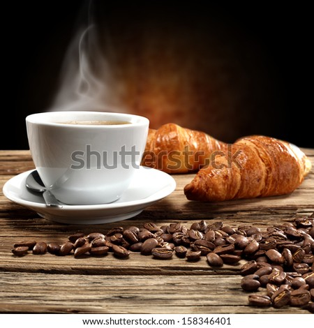 croissants coffee and beans  - stock photo