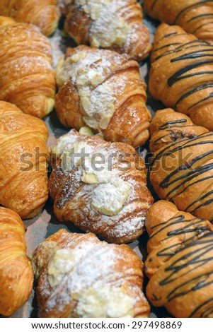 croissants on a shelf pastry shop - stock photo
