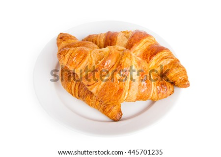 Croissants on a white plate isolated on white