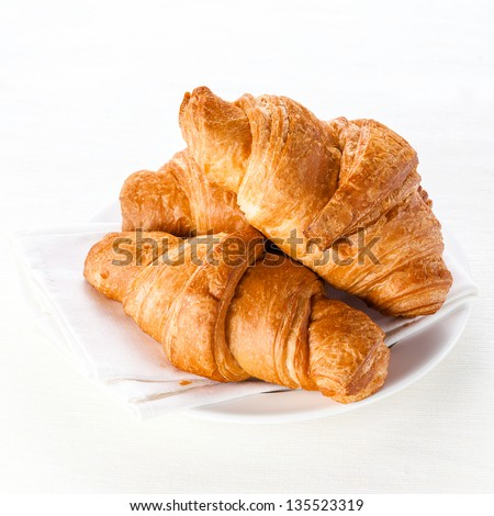 Croissants on white background - stock photo