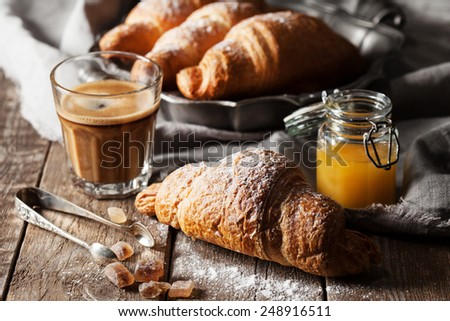 Croissants on wooden background - stock photo