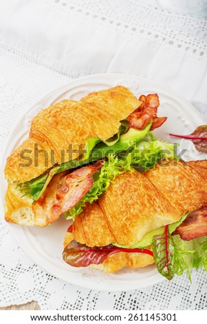 Croissants sandwiches on the light background. Selective focus - stock photo