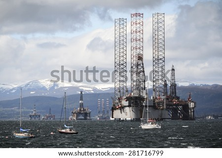 CROMARTY, UK - MAY 17: Boats and oil platforms on May 17, 2015 near Cromarty, UK.