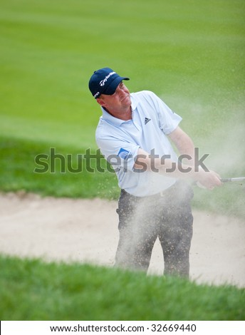 CROMWELL, CT - JUNE 25: Golfer Matt Bettencourt chips out of the sand trap at hole 5 at the Travelers Championship at TPC River Highlands Golf Course on June 25, 2009 in Cromwell, CT.