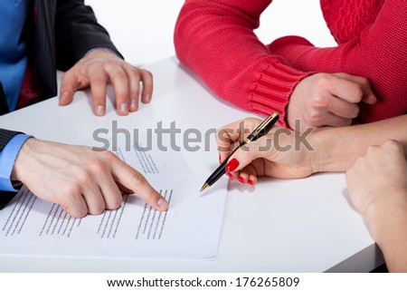 Crook convincing couple to sign unfair contract - stock photo