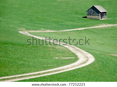 Crooked Road in the Meadow - stock photo