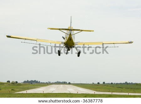 Crop duster prepares to land - stock photo