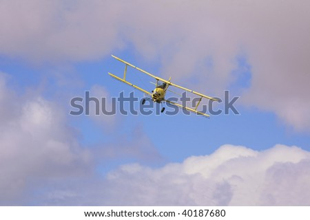Crop dusting aircraft spraying fields - stock photo