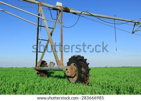 Crop Irrigation using the center pivot sprinkler system - stock photo