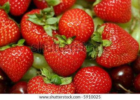 Crop of a red, ripe strawberry close up