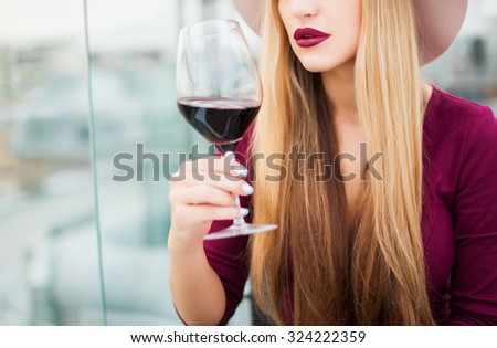 Crop photo,amazing make-up,full lips,red wine,elegant lady,long hairs.Fashion object of sensual lady,tan woman,toned,vintage colors,cool nail polish,nail art,blonde amazing hairstyle,sensual woman - stock photo