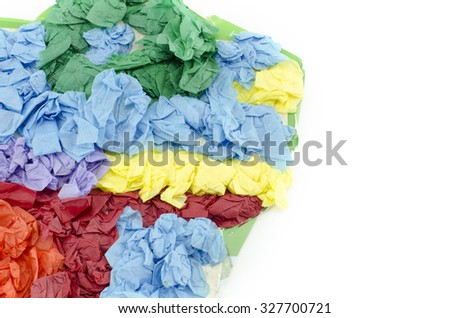 cropped abstract image of green, orange, yellow and blue crumple color paper on card board isolated on white background - stock photo