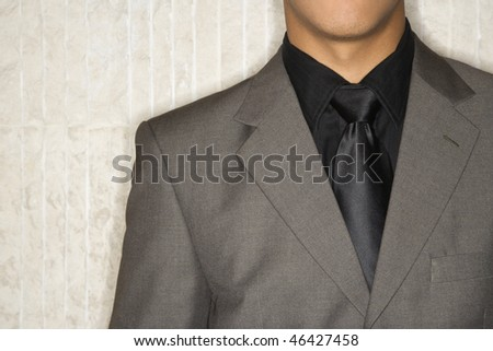 Cropped close-up of businessman's suit jacket and necktie. Horizontal format. - stock photo