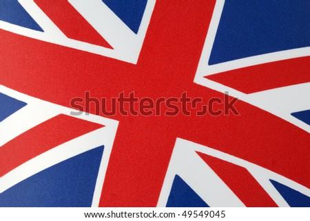 Cropped close-up of the Union Jack flag of the United Kingdom. Horizontal shot. - stock photo