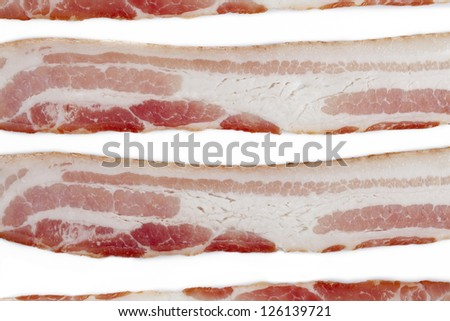 Cropped close-up shot of sliced bacon. - stock photo