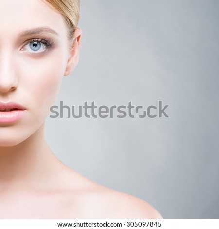 Cropped face of a beautiful woman with blue eyes. Skin care concept. - stock photo
