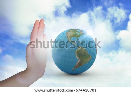 Cropped hand gesturing against blue sky with white clouds