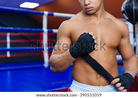 Cropped image of a boxer getting ready for fight - stock photo