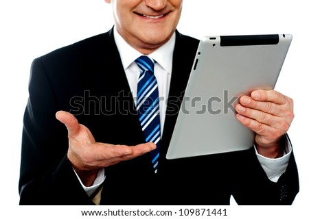 Cropped image of a businessman holding tablet pc isolated against white background - stock photo